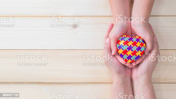 World autism awareness day mental health care concept with puzzle or picture id968637108?b=1&k=6&m=968637108&s=612x612&h=x9dxsnlncltbkemcrze0rd68md3mwtp1ad69e3jjlzm=