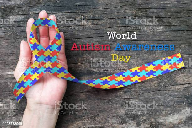 World autism awareness day with multicolor puzzle ribbon on persons picture id1128783968?b=1&k=6&m=1128783968&s=612x612&h=31pdybxl fxtfoiof8zmxpgbgw fses 5f34ruwo fc=