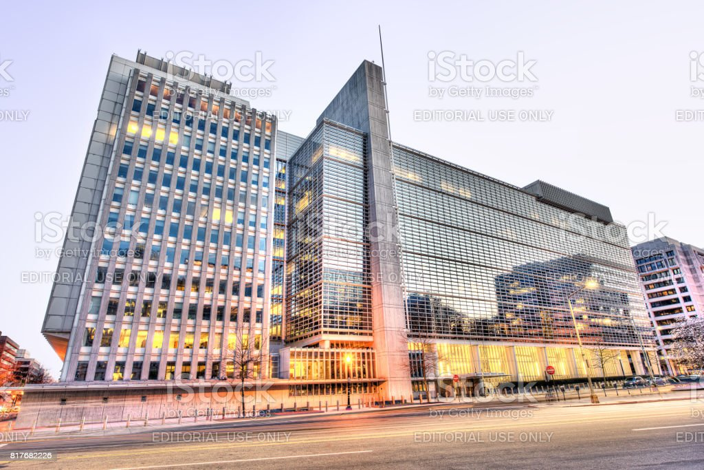 World Bank Group headquarters entrance, modern glass building with street during evening sunset stock photo