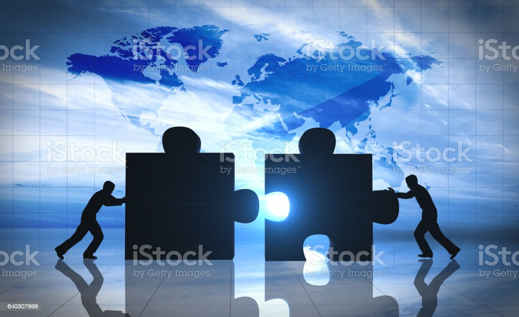World Business teamwork puzzle pieces - foto stock