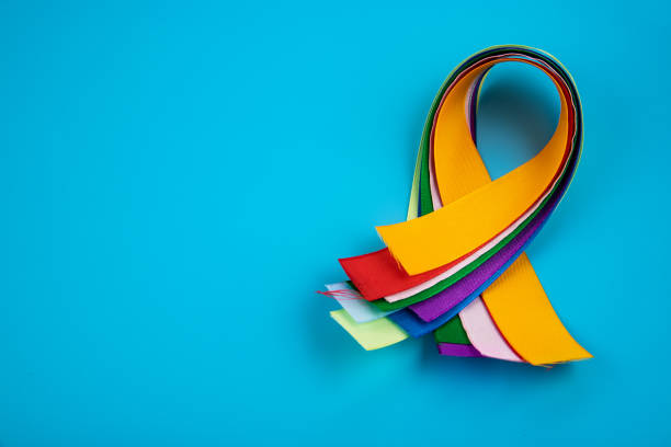 World Cancer Day February 4th. Multi-colored ribbons, symbols of the disease. Medical concept. The symbol of the struggle. stock photo