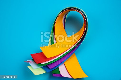 istock World Cancer Day February 4th. Multi-colored ribbons, symbols of the disease. Medical concept. The symbol of the struggle. 1219676151