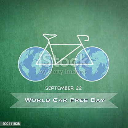 istock World car free day on September 22 with chalk drawing bicycle and world bike wheels on green chalkboard 900111908