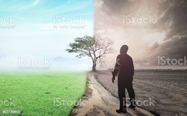 Business man standing between climate worsened with good atmosphere