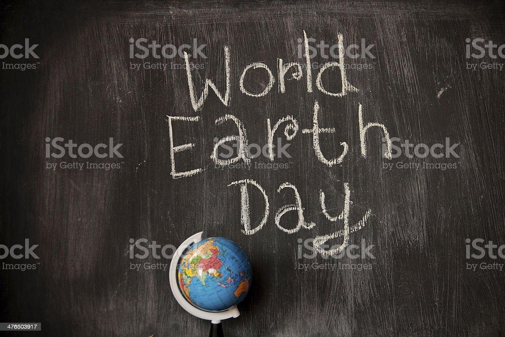 World Earth Day theme on blackboard royalty-free stock photo