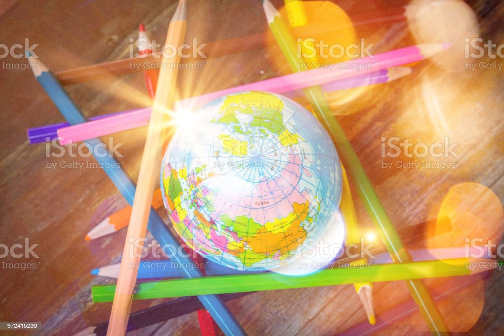 World education day, grunge small world color pencil with sunlight...