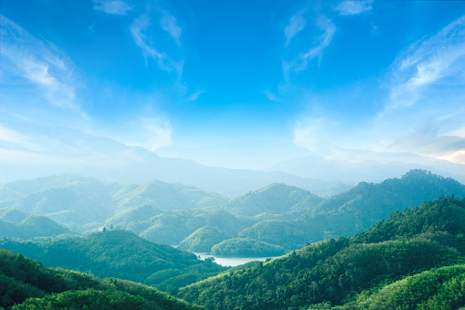World environment day concept: Green mountains and beautiful blue sky clouds