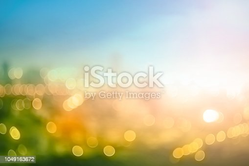 Abstract blur colorful bokeh city lights over autumn sunrise background