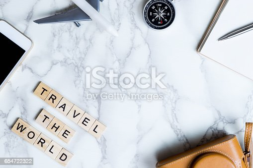 istock World Explorer blogger accessories on luxury white marble table with copy space in middle 654722322