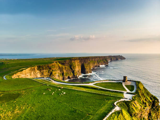 world famous cliffs of moher, one of the most popular tourist destinations in ireland. aerial view of known tourist attraction on wild atlantic way in county clare. - cliffs of moher stock pictures, royalty-free photos & images