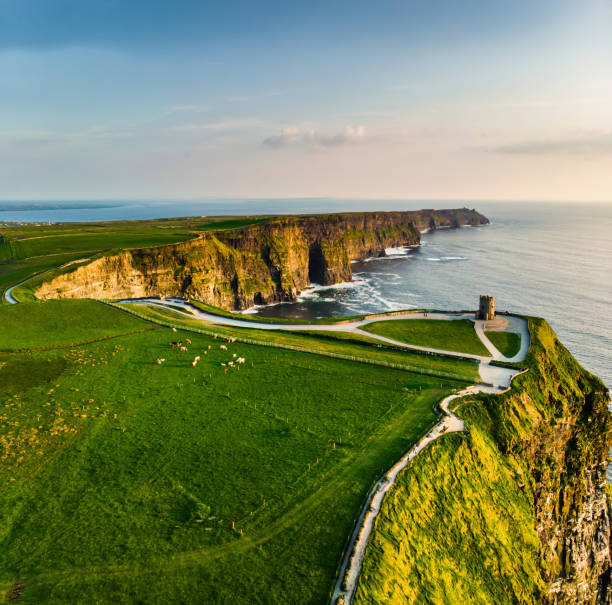 World famous Cliffs of Moher, one of the most popular tourist destinations in Ireland. Aerial view of known tourist attraction on Wild Atlantic Way in County Clare. stock photo