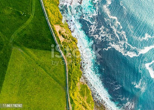 World famous Cliffs of Moher, one of the most popular tourist destinations in Ireland. Aerial view of widely known tourist attraction on Wild Atlantic Way in County Clare.