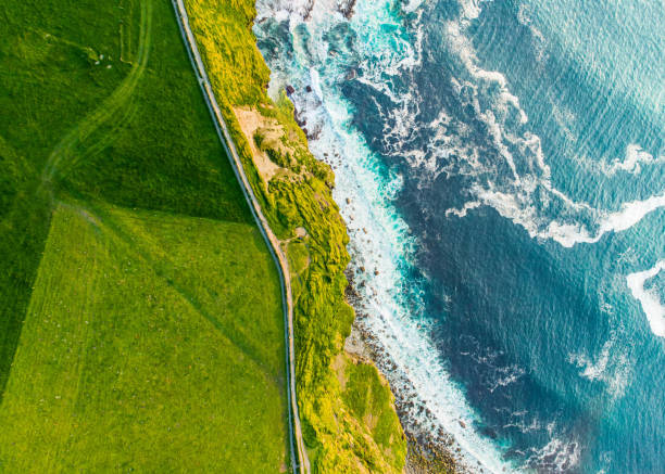 world famous cliffs of moher, one of the most popular tourist destinations in ireland. aerial view of known tourist attraction on wild atlantic way in county clare. - county clare stock pictures, royalty-free photos & images
