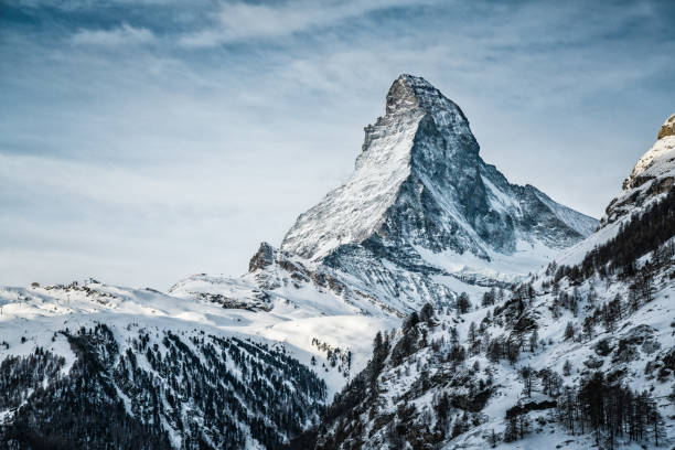 World famous mountain peak Matterhorn above Zermatt town Switzerland, in winter stock photo