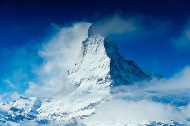 World famous mountain peak Matterhorn above Zermatt town Switzerland, in winter World famous mountain peak Matterhorn above Zermatt town in Mattertal, Valais canton, Switzerland, in winter. Taken by Sony a7R II, 42 Mpix. swiss alps stock pictures, royalty-free photos & images