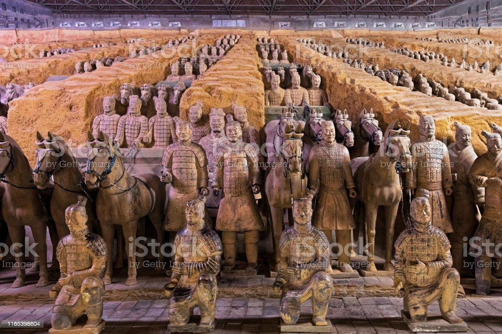 World famous Terracotta Army located in Xian China The world famous Terracotta Army, part of the Mausoleum of the First Qin Emperor and a UNESCO World Heritage Site located in Xian China Ancient Stock Photo