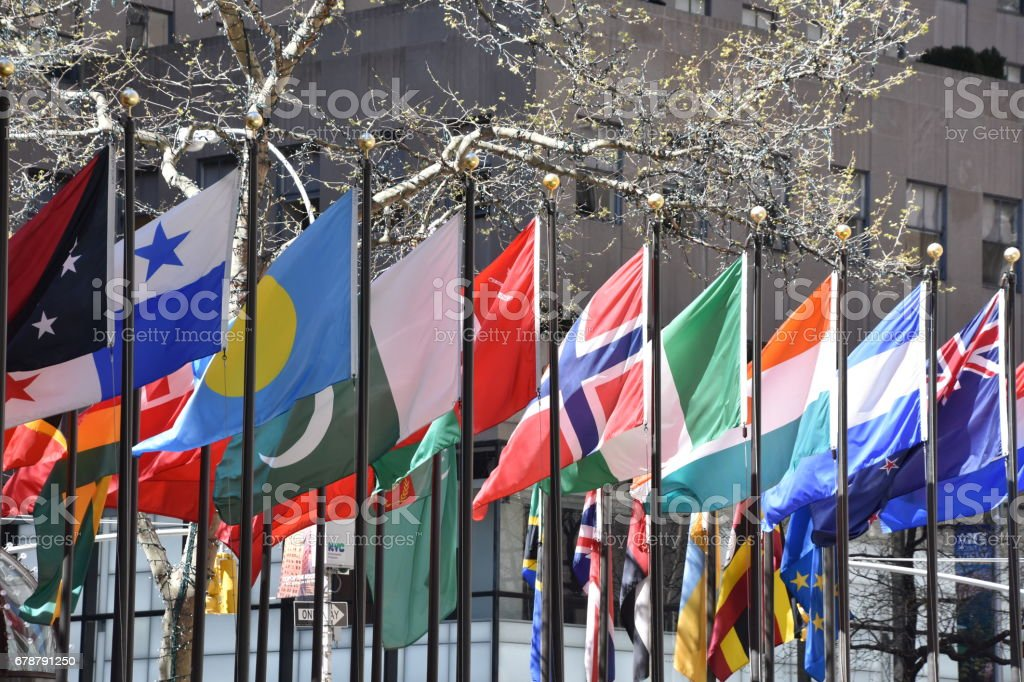 world flags at the entrance to the building stock photo