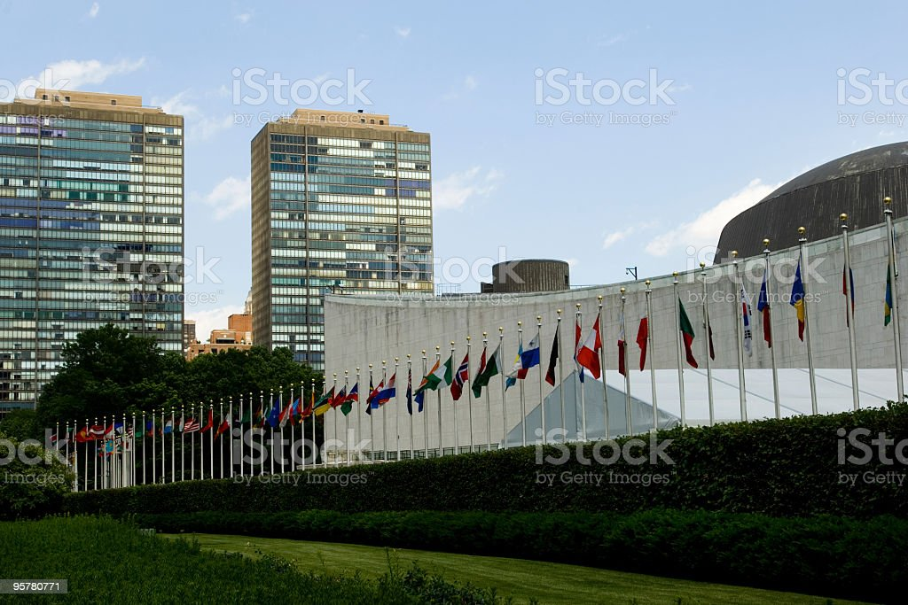 World flags in front of the United Nations building stock photo