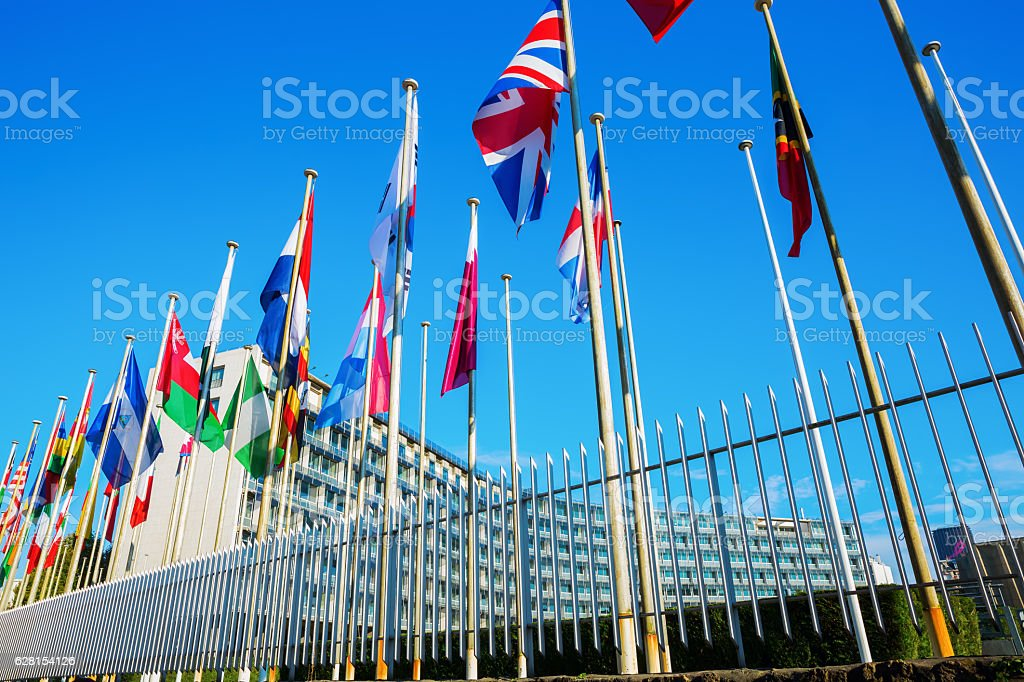 world flags in front of UNESCO headquarters in Paris, France stock photo
