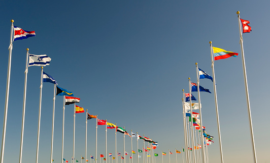 istock World flags on display bellow the blue sky 186858651