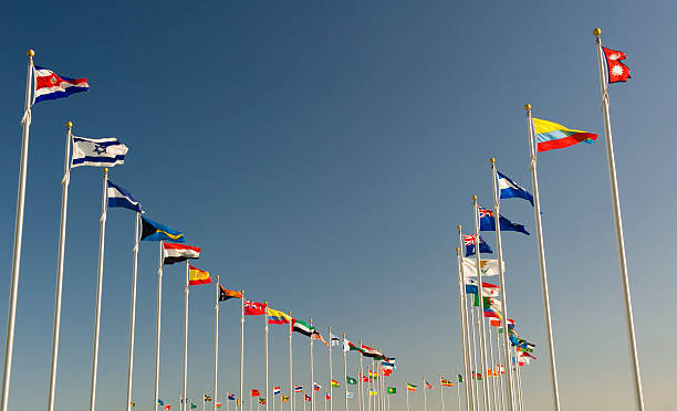 World flags on display bellow the blue sky stock photo
