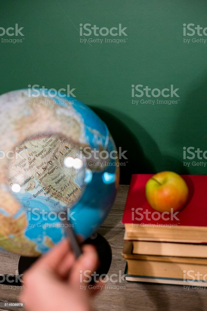 world globe and a magnifying glass stock photo