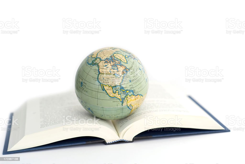 world globe on a open book stock photo