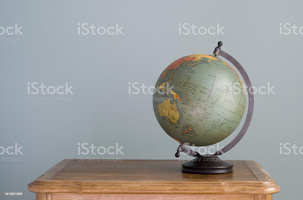 World globe sits on surface royalty-free stock photo