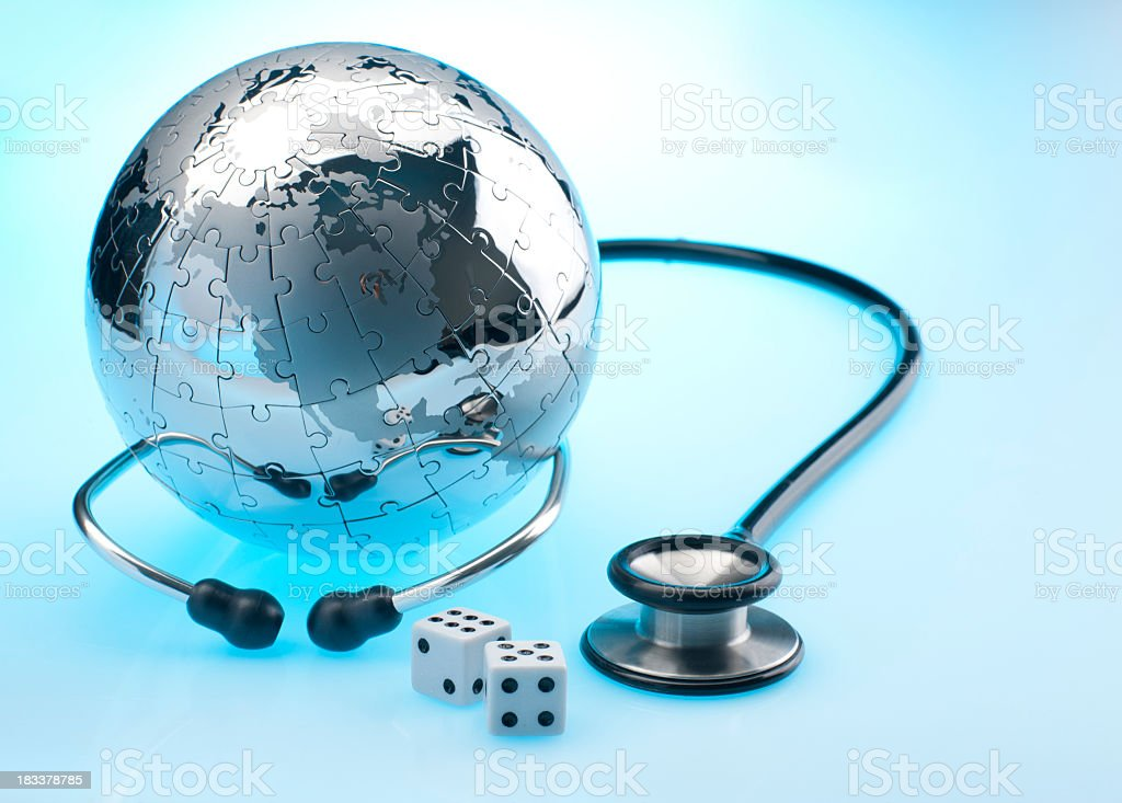 World globe with stethoscope and dice royalty-free stock photo