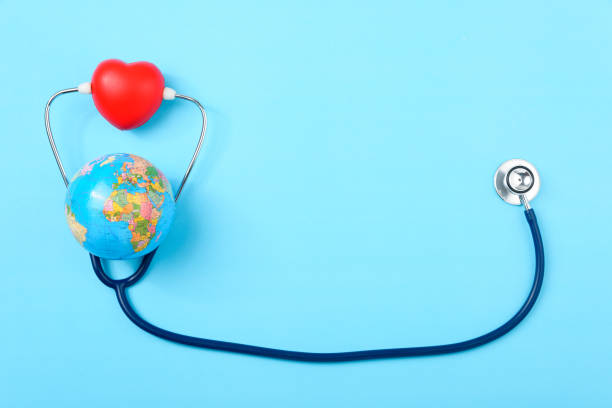 World health day concept, Stethoscope, globe and red heart on blue background with copy space World health day concept, Stethoscope, globe and red heart on blue background with copy space. Global health care world health day stock pictures, royalty-free photos & images