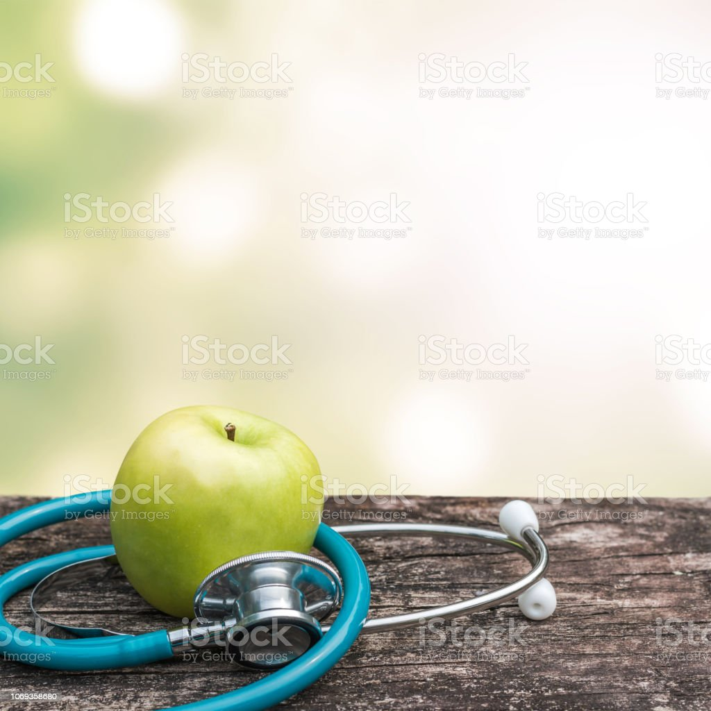 World health day concept with green natural nutrient apple with...