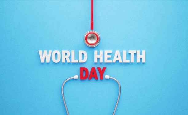 World Health Day Concept - World Health Day Message And Red Stethoscope Sitting On Blue Background Red stethoscope and  World Health Day message sitting on blue background. Directly above. Horizontal composition with copy space. World Health Day concept. world health day stock pictures, royalty-free photos & images