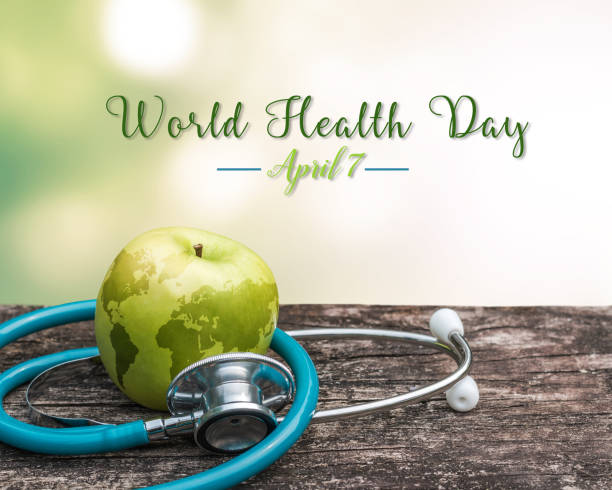 World health day symbolic concept with map on healthy nutritional apple with doctor's stethoscope World health day symbolic concept with map on healthy nutritional apple with doctor's stethoscope world health day stock pictures, royalty-free photos & images