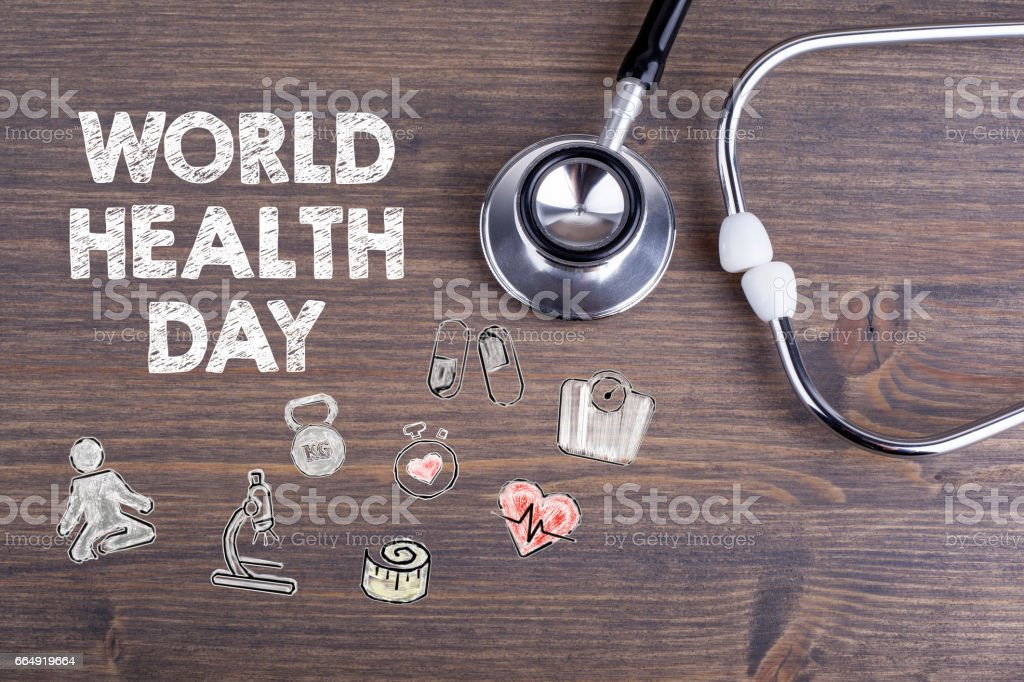 World health day. Workplace of a doctor. Stethoscope on wooden desk background stock photo
