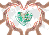 istock World heart day and environmental protection concept with love earth in community volunteer's hands. Element of this image furnished by NASA 1017943458