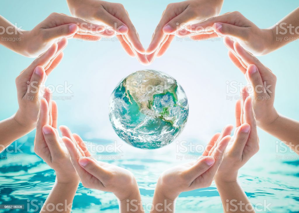 World heart day and environmental protection concept with love earth in community volunteer's hands. Element of this image furnished by NASA zbiór zdjęć royalty-free
