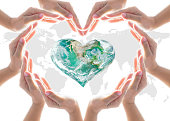 istock World heart health day concept with collaborative hands protection in heart shape: Elements of this image furnished by NASA 1001814214