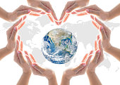 istock World heart health day concept with collaborative hands protection in heart shape: Elements of this image furnished by NASA 962719846