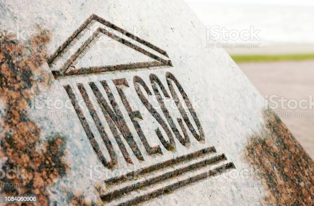Juodkrante, Lithuania - 18 August, 2017: Close up picture of UNESCO world heritage sign or logo carved on stone
