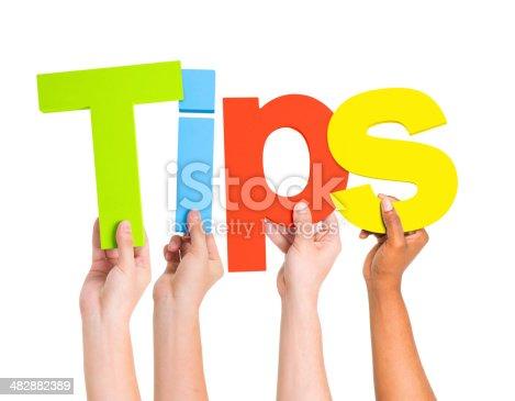 istock World Human Hands Holding Word Tips 482882389