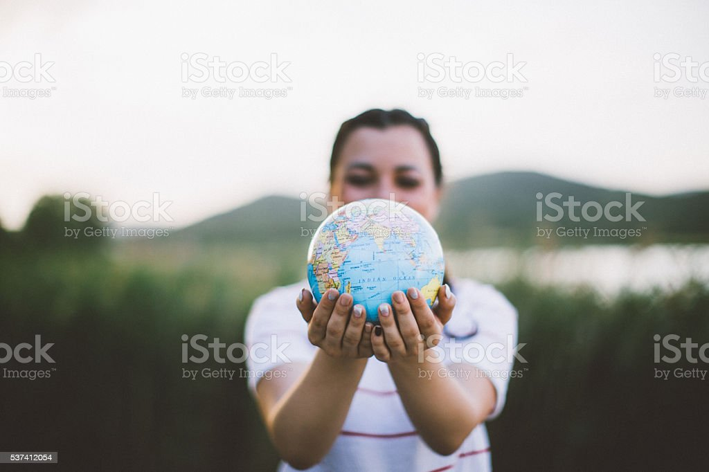 World in my hands! stock photo