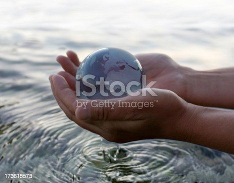 istock World in the hand 173615573
