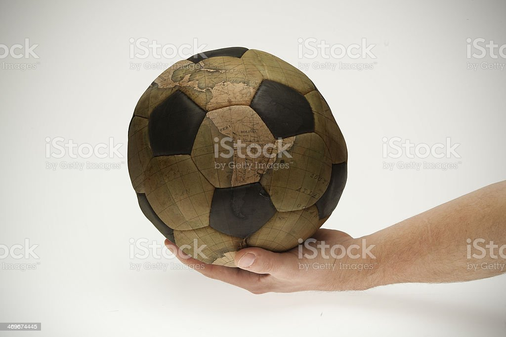 world is governed by football stock photo