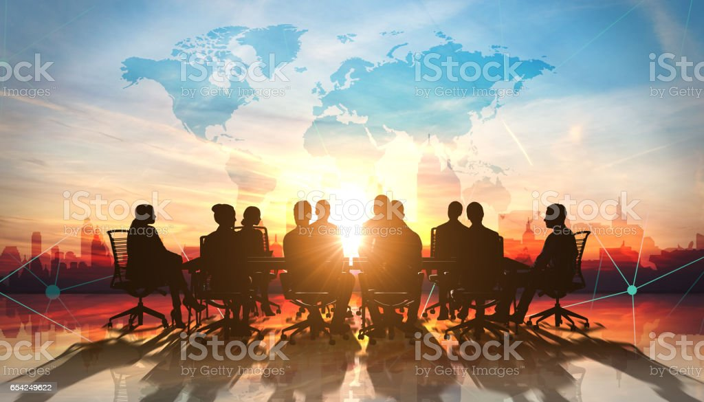World Management Team in office silhouette stock photo