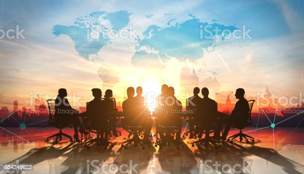 World Management Team In Office Silhouette Stock Photo - Download Image Now