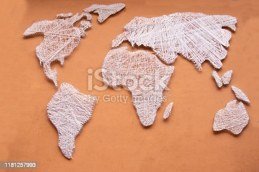 538675410 istock photo World map designed on brown back grown by silk thread 1181257993