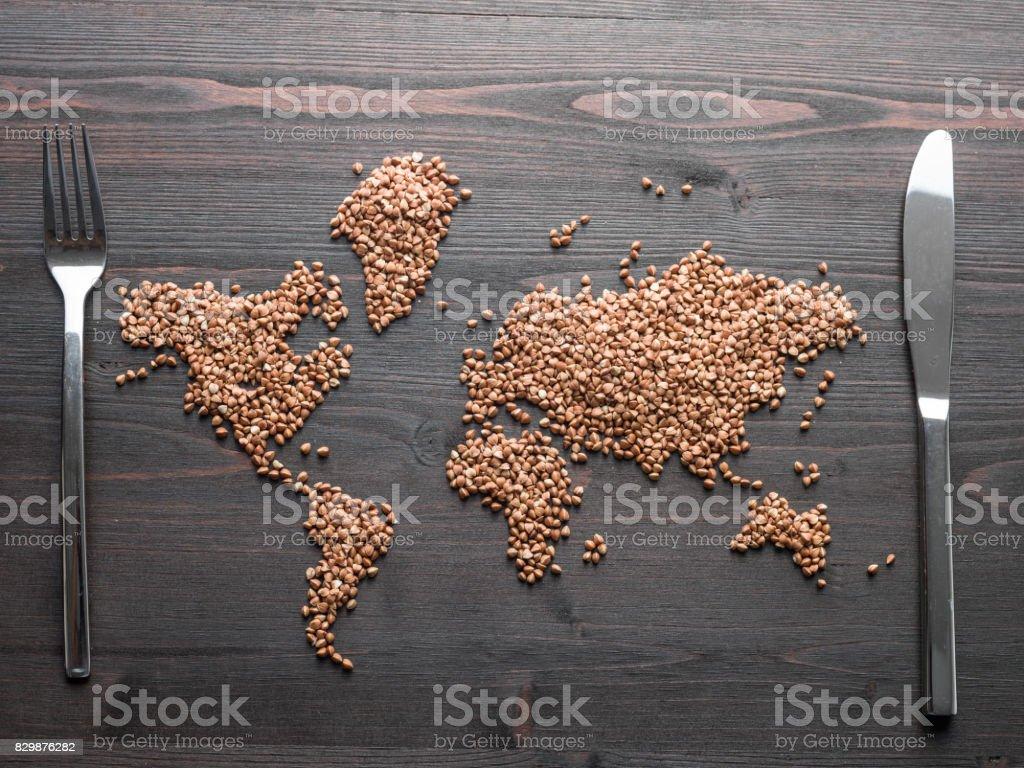World Map Made Of Buckwheat Grain Seeds On Wooden Desk stock photo