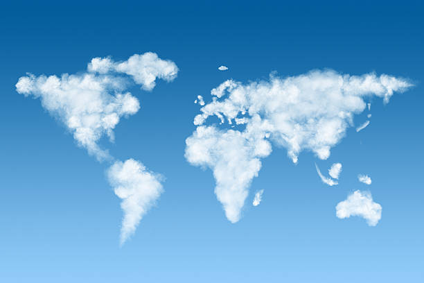 world map made of white clouds on sky stock photo