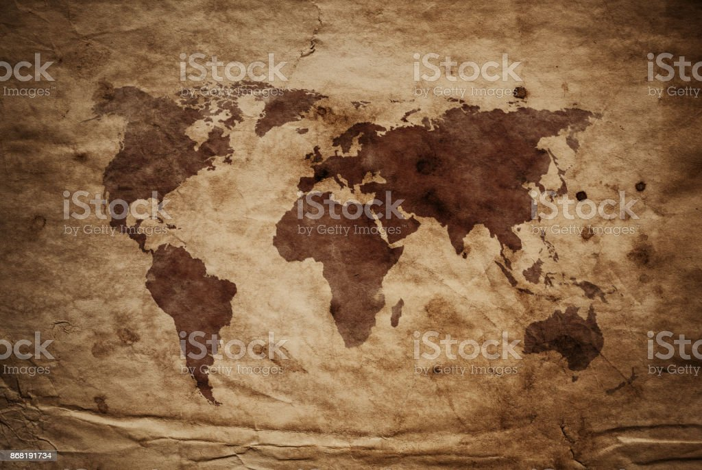 World Map on aged damaged paper stock photo