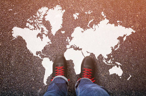 World map on an asphalt road World map on an asphalt road single step stock pictures, royalty-free photos & images
